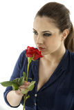 Young brunette with a beautiful red rose Royalty Free Stock Image