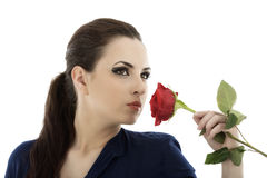 Young brunette with a beautiful red rose Stock Image