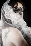 Young brunette beauty or bride, behind a white veil, spain Stock Photos