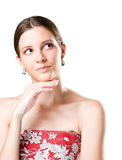 Young brunette beauty with thinking gesture. Royalty Free Stock Photography