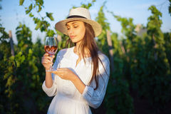 Young brunette beauty in the vineyards. Royalty Free Stock Photos