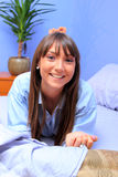 Young brunette in bed Stock Photo