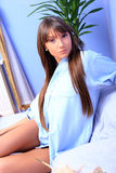 Young brunette in bed Stock Photos