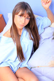 Young brunette in bed Royalty Free Stock Photography