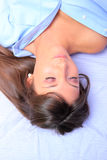 Young brunette in bed Stock Image