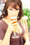 Young brunette with beer glass Royalty Free Stock Image