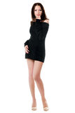 Young brunette in black dress Royalty Free Stock Photos