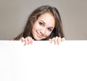 Young brunette with blank board. Royalty Free Stock Photo