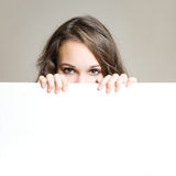 Young brunette with blank board. Royalty Free Stock Photography