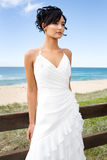 Young brunette bride on beach Stock Images