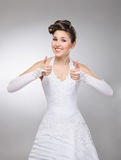 A young brunette bride holding thumbs up Stock Image