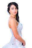 Young brunette bride in wedding dress on white Stock Photo