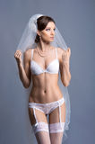 A young brunette bride in white erotic lingerie Royalty Free Stock Photo