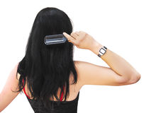 Young brunette brushing her hair Royalty Free Stock Photos