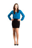 Young brunette business woman with arms on her hips Stock Photos