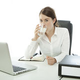 Young brunette business woman is drinking water Stock Photography