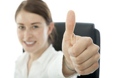 Young brunette business woman thumb up and smile Royalty Free Stock Photo