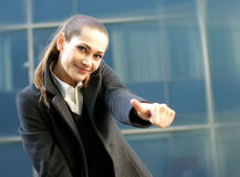 A young brunette businesswoman in formal clothes Stock Image
