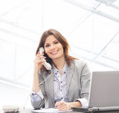 A young brunette businesswoman in formal clothes Royalty Free Stock Image