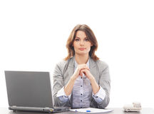 A young brunette businesswoman in a modern office Stock Photo