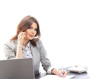 A young brunette businesswoman on the phone Stock Photography