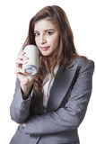 Young brunette businesswoman presenting a can of soft drink Stock Images