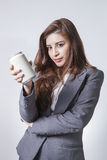 Young brunette businesswoman presenting a can of soft drink Stock Photos