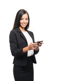 A young brunette businesswoman with a smartphone Stock Photography