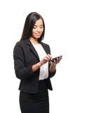 A young brunette businesswoman with a smartphone Stock Photo