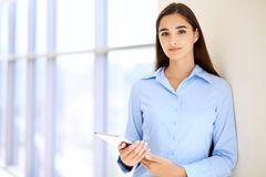 Young brunette businesswoman or student girl looking at camera.  Stock Image