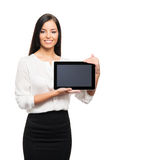 A young brunette businesswoman with a tablet computer Stock Photos