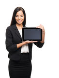 A young brunette businesswoman with a tablet computer Royalty Free Stock Images