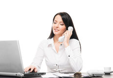 Young brunette businesswoman talking on the phone Stock Photography