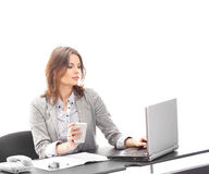 A young brunette businesswoman at work Royalty Free Stock Images