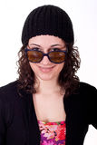 Young Brunette in Cap Looking Over Sunglasses Stock Photography