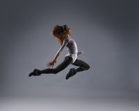 A young brunette Caucasian female dancing woman Stock Photography