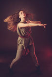 Young brunette caucasian woman dancing and her hair flowing through the air Royalty Free Stock Photography