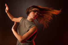 Young brunette caucasian woman dancing and her hair flowing through the air Royalty Free Stock Photos