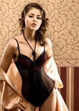 A young brunette Caucasian woman in dark lingerie Royalty Free Stock Photo