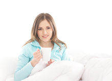 A young brunette Caucasian woman holding a cup Royalty Free Stock Photos