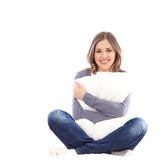 A young brunette Caucasian woman holding a pillow Stock Images