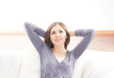 A young brunette Caucasian woman relaxing Royalty Free Stock Images