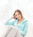 A young brunette Caucasian woman relaxing Stock Photos