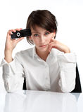 Young brunette with cellphone. Upset and sad. on white background royalty free stock photo