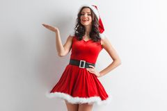 Christmas girl holding something Stock Images