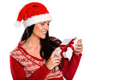 Young brunette with christmas present Royalty Free Stock Photography