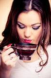 Young brunette with coffee Royalty Free Stock Image