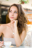Young brunette at the coffee shop. Stock Photography