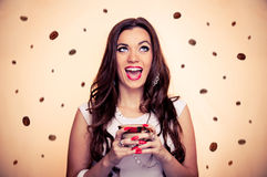 Young brunette and coffee Royalty Free Stock Images