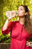 Young brunette with cool refreshment. Stock Photos